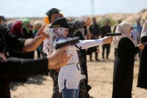Young Palestinian girls gets firearms training in the Gaza Strip by Hamas soldiers who are preparing them to fight the Israeli's.