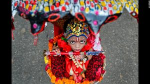 A little child leads a celebration in Bangladesh in honor of the birthday of the great Hindu god, Krishna.