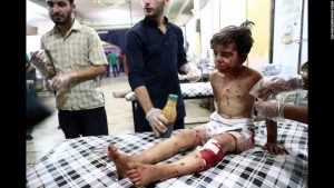A child waits for a doctor after yet another terrifying airstrike as the civil war in Syria continues to rage with no end in sight.