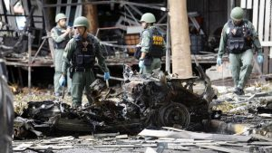 Thailand's bomb squad checks out a car bomb that exploded at a hotel in downtown Pattani, Thailand. A least one person is dead and over 30 are wounded.