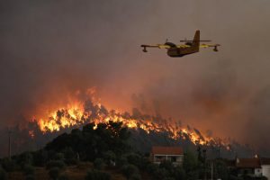 A water tanker plane heads toward the massive wildfires that have been raging throughout Portugal.