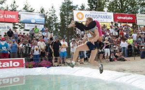 In this Olympic like timed sport, men sling their wives over their shoulders and race through a demanding and perilous obstacle course. The North American Championships are held every August in Maine and the winner receives five times his wife's weight in cash, his wife's weight in beer, and automatic entry into the World Wife Carrying Championships in Finland where the sport originated in 1991.