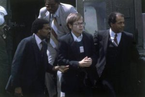 Hinckley, Jr. being apprehended and led away from the scene of the shooting on March 31, 1981.