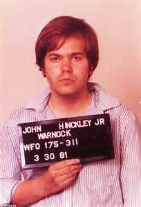 Hinckley, Jr. being booked and charged with the attempted murder of President Reagan.