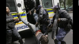 South African police, dressed as soldiers, continue to crack down on college students all over the country. The students have been protesting, for nearly a year, over recent hikes in college fees and tuitions.