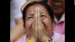 A Thai woman prays as the country of Thailand remained in mourning for King Bhumibol who died last week at the age of 88. He was the longest ruling king in Thai history.